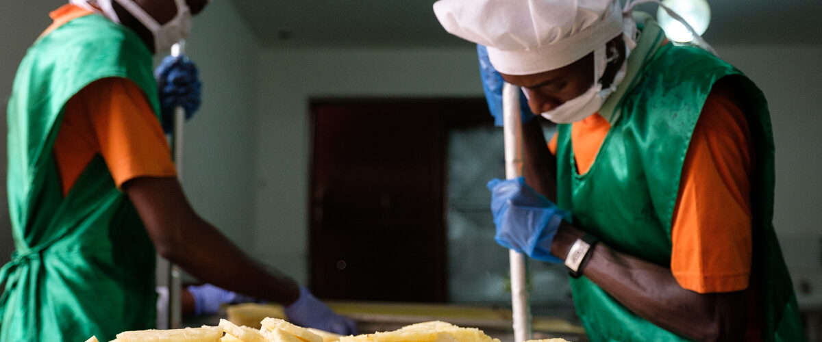 The workers remove the pineapple hearts and arrange the slices on a tray
